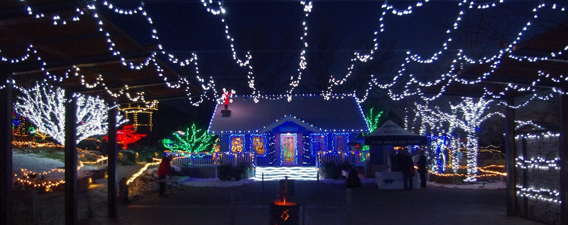 A photo of a house covered in Christmas lights